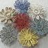Цветы, сплетенные из скрученных нитей
